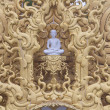 White Buddha statue in a gold frame — Stock Photo