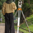 Stock Photo: Land surveyor working