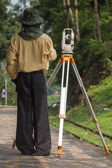 Land surveyor working — Stok fotoğraf