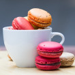 Stock Photo: Macaron in coffee cup
