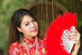Beautiful Asian girl with Chinese traditional dress Cheongsam  — Foto de Stock