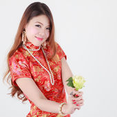 Sexy Chinese women dress traditional cheongsam showing flower — Stock Photo