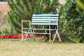 Vintage old bench on hill garden — Stock Photo