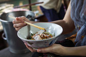 Woman eating noodles — Stock Photo