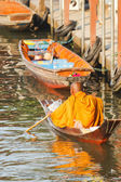 Thai monk on boat — Stock Photo