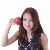 Asian woman eating an apple. — Photo