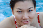 Asian woman enjoy and relaxing in spa pool on vacation — Stock Photo