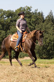 Outdoor Ride - young Woman on brown Quarter Horse — Stock Photo