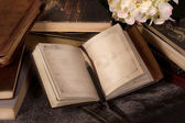 Notebook with flower and books — Stock Photo