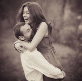 Sepia, beautiful embrace couple in the park — Stock Photo