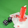 Stock Photo: Playing cards, dice and candle