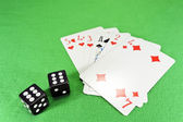 Playing cards, dice on cloth — Stock Photo