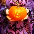 Holding Jack O Lantern — Stock Photo #33810341