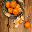 Stock Photo: Clementines On Wooden Board