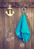 Aqua blue towel hanging in the bathroom with anchor — Stok fotoğraf