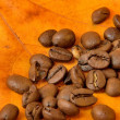 Stock Photo: Coffee beans on autumn leaves