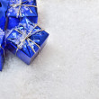 Christmas gifts in the snow — Stock Photo