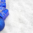 Christmas gifts in the snow — Stock Photo #15078497
