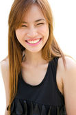 Beautiful Asian woman laughing — Stock Photo