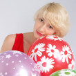Girl with balloons — Stock Photo #13987700