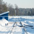 Railway in the snow. Sunny day. - Stock Photo