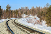 Railway in the snow. Sunny day. — Stock Photo