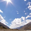 Clouds and sun in the mountains. Kirgystan, central Tien Shan — 图库视频影像