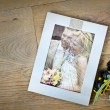 Royalty-Free Stock Photo: Broken picture frame of married couple