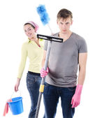 Man and woman cleaning the house — Stock Photo