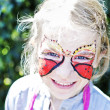 Girl with painted face — Stockfoto