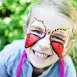 Girl with painted face — Stock Photo