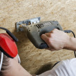 Cutting plywood with electrical saw - Stok fotoğraf