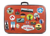 Old suitcase with stickers — Stock Photo