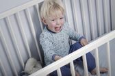 Crying boy in bed — Stock Photo