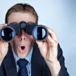 Stock Photo: Businessman looking through binoculars