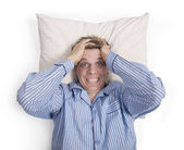 Man in bed worried or stressed — Stock Photo