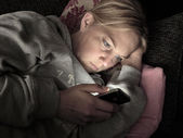 Woman on smartphone at night — Stock Photo