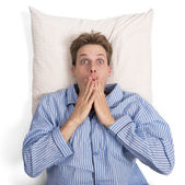 Man in bed frightened — Stock Photo