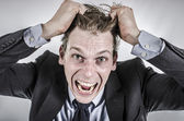 Businessman going crazy — Stock Photo