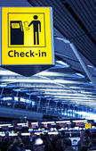 Closeup of check-in sign on airport — Stock Photo