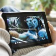 Watching movies online on iPad — Stock Photo