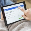 Using Facebook on tablet pc — Stock Photo