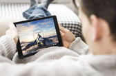 Watching movie on iPad — Stock Photo