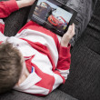 Boy watching movie on iPad — Stock Photo