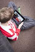 Boy watching movie on iPad — Stock Photo