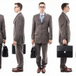 Businessmwith suitcase from all sides — Stock Photo #41210057