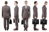 Businessman with suitcase from all sides — Stock Photo