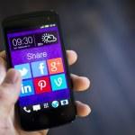 Social media icons on smartphone screen — Stock Photo