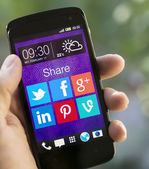 Social media icons on smartphone screen — Stock Photo