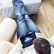 Man watching movie on iPad — Stock Photo